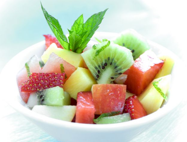 bowl of fruit salad on blue