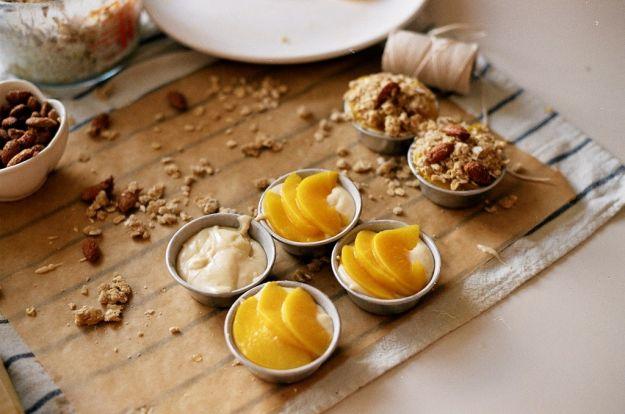 peach cream cakes: white cake, vanilla bean pastry cream filling, peaches topped w brown sugar/oatmeal streusel and sugared almonds